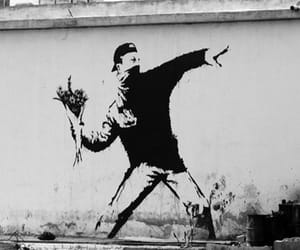 graffiti, BANKSY, and flowers image