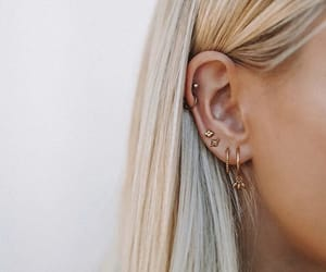 ear, syden。, and piercing image