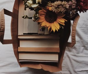 book, flowers, and sunflowers image