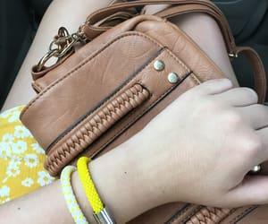 bracelets, yellow bracelet, and charm bracelet image