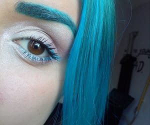 blue hair, blue eyebrows, and makeup image
