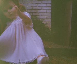 35mm, doll, and expired film image