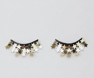 stars, eyes, and gold image