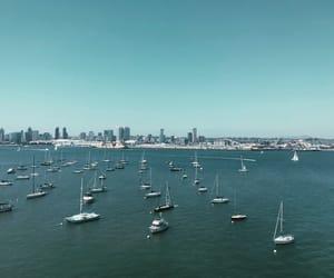 bay, ocean, and sailboat image