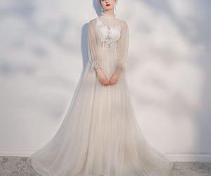 backless, long sleeve, and beach wedding dresses image