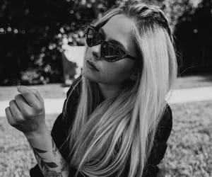 Avril Lavigne and little black stars image