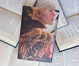 book cover, gold, and raven image