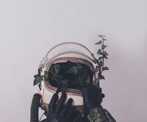 green, astronaut, and plants image