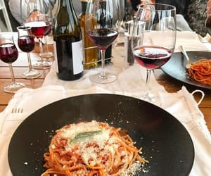pasta, red wine, and wine image