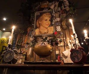 eva peron shrine, peron peron resto bar, and evita portrait painting image
