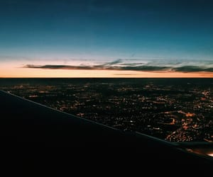 city, plane, and sunset image
