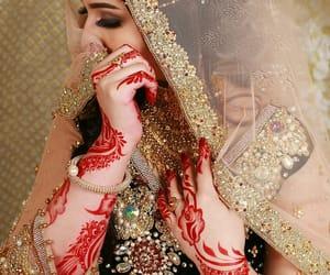bride, henna, and makeup image