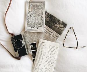 newspaper, book, and camera image