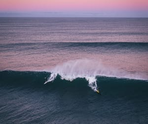 sunset, surf, and sea image