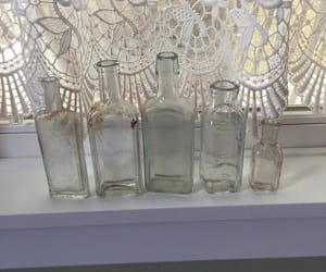 hires, centerpiece vases, and clear glass bottles image