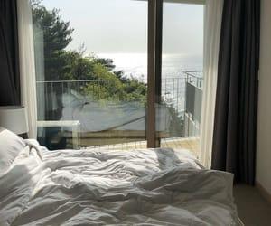 balcony, bedroom, and ocean image
