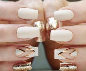 gold, ivory, and nails image