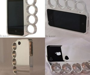 brass knuckles and silver iphone case image