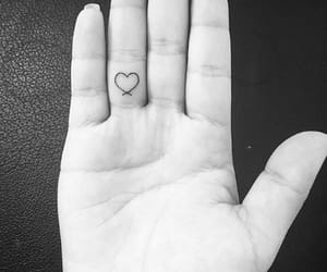 finger, heart, and tattoo image