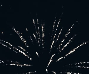 black, white, and fireworks image