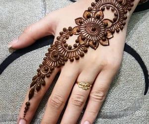 eid mubarak, henna, and mehndi image