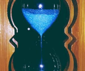 blue, hourglass, and sparkles image