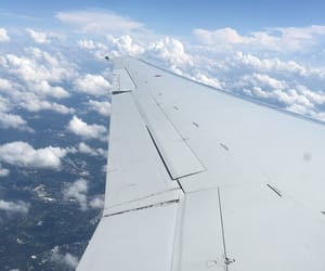 plane window, window view, and on the plane image