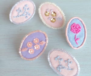 embroidery and pierced earrings image