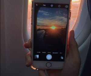 plane, sky, and sun image