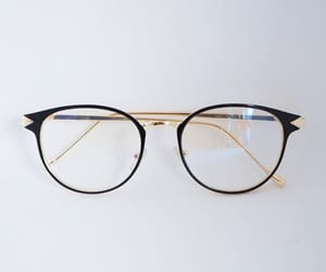 black, gold, and glasses image