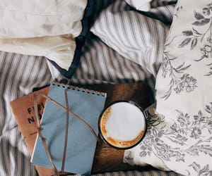 bed, notebook, and pillow image