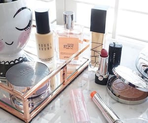 blush, perfume, and products image