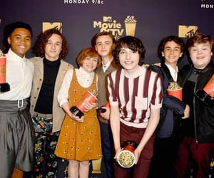 wyatt oleff, finn wolfhard, and it cast image