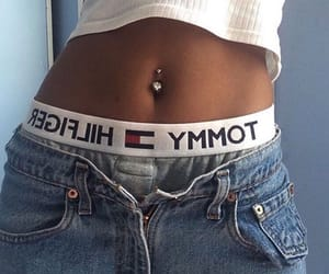 tommy hilfiger, piercing, and jeans image