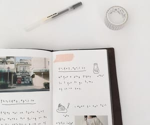 book, pen, and black image