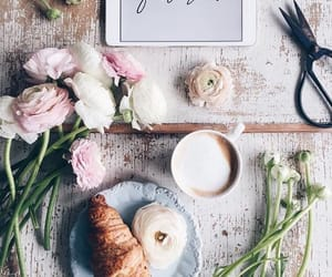 coffee, flowers, and croissant image