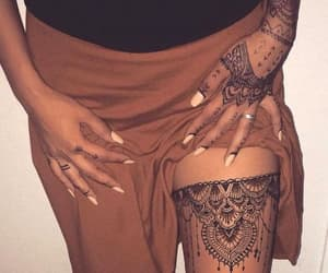 hands, leg, and tattoo image