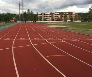 running, sun, and track image