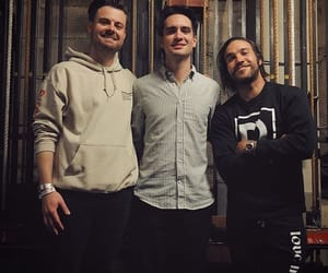 brendon urie, fall out boy, and panic at the disco image