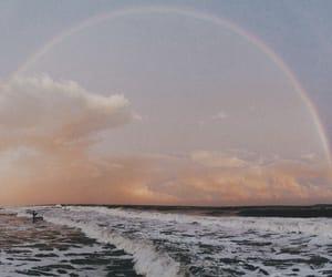 rainbow, sky, and sea image