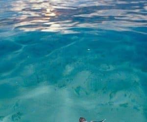 beach, sun, and ocean image
