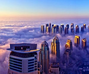 city, clouds, and Dubai image