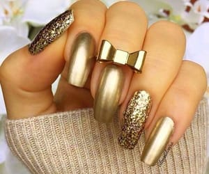 gold, hand, and luxe image