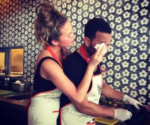 cooking, couple, and chrissy teigen image