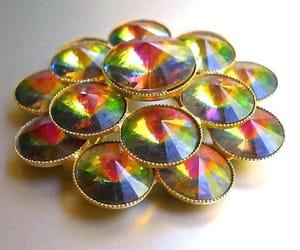 brooch, flower brooch, and rainbow image