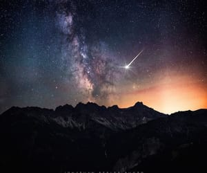 galaxy, mountains, and shooting stars image