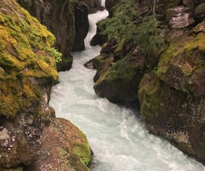 flowing, rocks, and scenery image