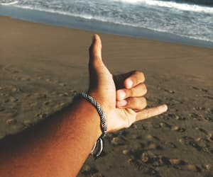 beach, hand, and surf image