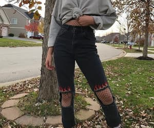 black jeans, fishnets, and sweater image