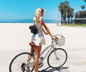 bycicle, dress, and sneakers image